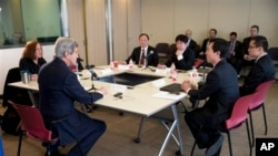 U.S. Secretary of State John Kerry, foreground left, hosts a discussion with Chinese bloggers on a number of issues on Saturday, Feb. 15, 2014, in Beijing.