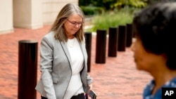 Tax preparer Cynthia Laporta leaves the Alexandria Federal Courthouse in, Alexandria, Va., Aug. 3, 2018, on day four of Paul Manafort's tax evasion and bank fraud trial.