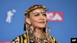 FILE - Madonna poses in the press room at the MTV Video Music Awards at Radio City Music Hall, Aug. 20, 2018, in New York.