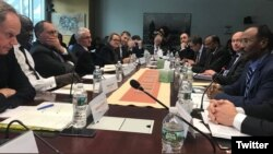 Somali Finance Minister Abdirahman Duale Beileh (right) is seen with participants of International Monetary Fund (IMF) and World Bank meetings last week in Washington. (Twitter - @DrBeileh)
