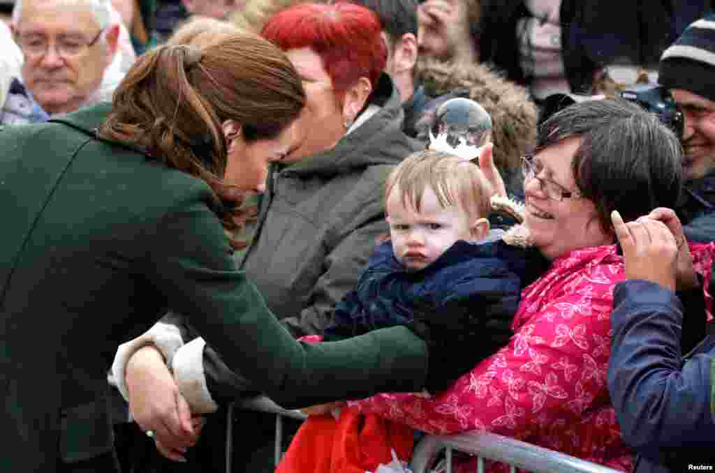 Catherine, Duchess of Cambridge, greets people outside the Blackpool Tower in Blackpool, Britain.