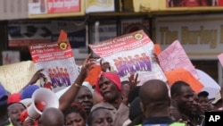FILE: Zimbabwean workers demonstrate against the high cost of living and low wages in Harare, Saturday, April, 11, 2015. ( AP Photo/Tsvangirayi Mukwazhi)