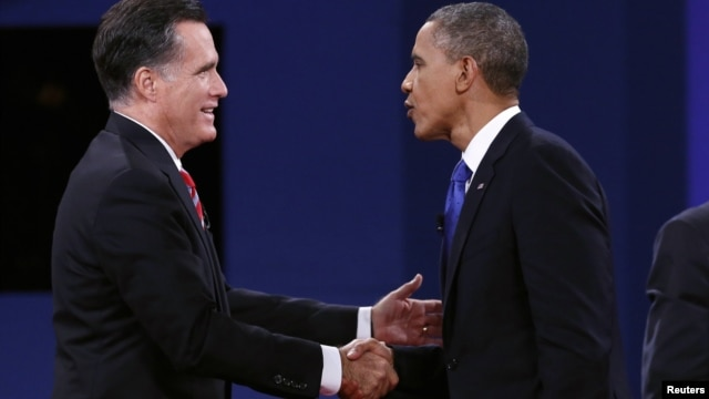 U.S. President Barack Obama (R) and Republican Presidential nominee Mitt Romney shake hands at the conclusion of the final presidential debate at Lynn University in Boca Raton, Florida October 22, 2012.