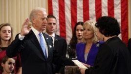 Vice President Joseph Biden, Jr. takes the oath of office, administered by Associate Supreme Court Justice Sonia Sotomayor in the residence of the vice president in Washington, January 20, 2012.