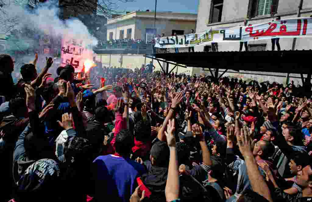 Egyptian Ultras, hard-core soccer fans, chant anti-government slogans in front of the Giza security directorate, March 6, 2013.