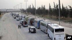 bas dadka ka guraya Bariga Ghouta, Syria.