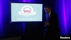 奧巴馬去年末推銷醫保計劃(資料圖片)
