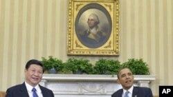 美国总统奥巴马(右)和中国国家副主席习近平(左)2月14日在白宫椭圆形办公室会晤