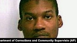 FILE- Emanuel Lutchman, of Rochester, New York, was sentenced Thursday to 20 years in prison and 50 years of supervised release on terrorism charges.