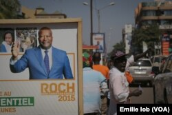 An electoral poster of candidate Roch Marc Christian Kaboré is displayed on the streets of Ouagadougou, Burkina Faso, Nov. 27, 2015.