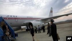FILE - Passengers disembark an Air Koryo flight in Pyongyang, North Korea.