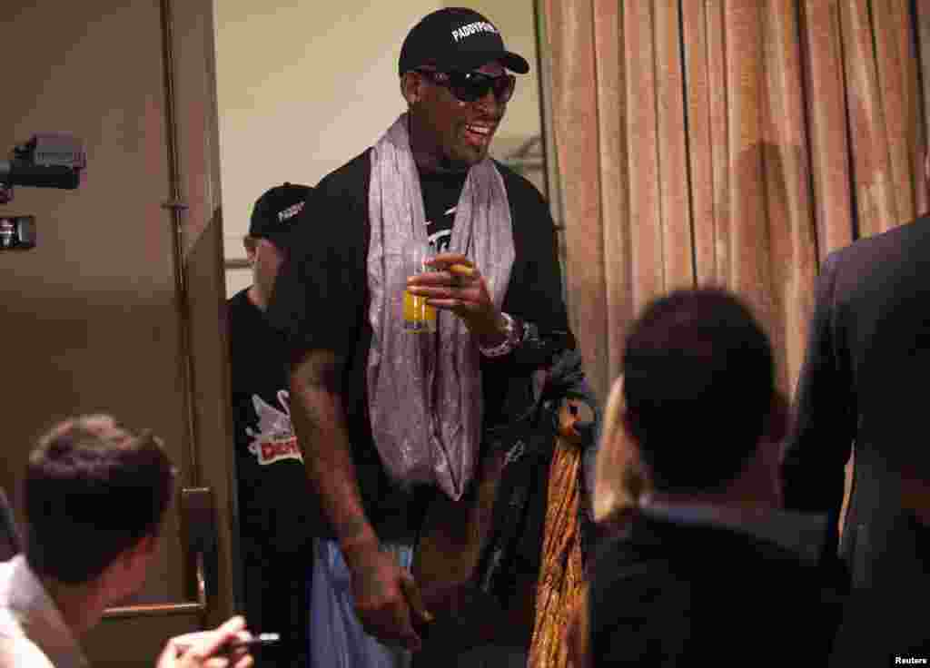 Dennis Rodman arrives for a news conference in New York, Sept. 9, 2013.