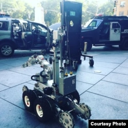 A New York police robot sits on the sidewalk close to a suspect's vehicle in New York City, July 21, 2016.