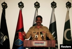 FILE - Major General Asif Ghafoor, director general of Inter-Services Public Relations (ISPR), speaks during a news conference in Rawalpindi, Pakistan, April 17, 2017.