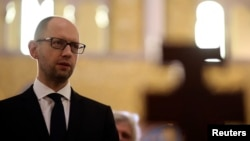 Ukrainian Prime Minister Arseniy Yatsenyuk visits the Santa Sophia Church in Rome, Apr. 26, 2014.