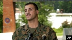 FILE - Marine Cpl. Wassef Ali Hassoun makes a statement to the press outside Quantico Marine Base in Quantico, Virginia, July 19, 2004.