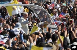 FILE - Pope Francis arrives on the pope-mobile to the Maquehue Air Base, to celebrate a Mass in Temuco, Chile, Jan. 17, 2018.