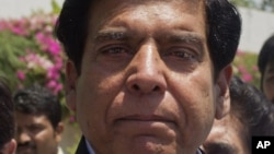 Raja Pervaiz Ashraf is seen as he leaves the Parliament in Islamabad, Pakistan after filing his nomination as a candidate for the premiership. June 21, 2012