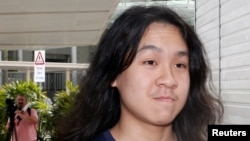 FILE - Teen blogger Amos Yee arrives at the State Courts in Singapore, Sept. 28, 2016. Inflammatory blog posts landed him in jail twice in his home country. He's now seeking asylum in the United States.