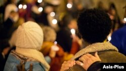 FILE - Community members gather during a candlelit vigil in support of legislation for child victims of human trafficking, Dec. 11, 2014, in Atlanta.