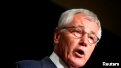 """FILE - U.S. Defense Secretary Chuck Hagel is expected to soon decide whether to subject all U.S. troops returning from Ebola response efforts to a """"quarantine-like"""" period."""