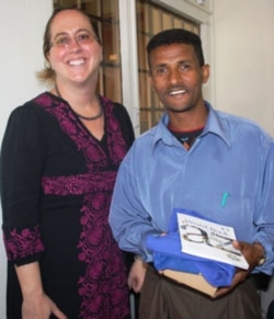 Haileselassie Tesfay with Julie McClanahan, public affairs officer at the American Embassy in Asmara, Eritrea.