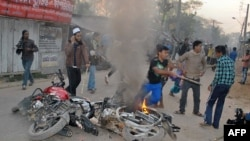 Bangladeshi Islamist activists vandalize motor bikes in Barisal, some 142 kms south the capital Dhaka, March 4, 2013.