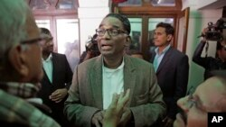 FILE -Indian Supreme Court judge Justice Jasti Chelameswar (C) speaks to reporters, after addressing a press conference in New Delhi, India, Jan. 12, 2018. He is one of four Supreme Court judges complaining openly about the functioning of the top court and the role of the chief justice.