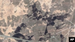 Satellite image of El Feid, South Kordofan State, Sudan, showing burned village