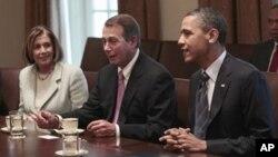 奥巴马总统4月13日在两党会议中倾听众院议长贝纳的看法