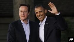 英國首相卡梅倫(右)和美國總統奧巴馬(右)在G-20峰會會面握手。