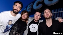 (From L to R) Members of the British electro-pop band Bastille, Kyle Simmons, Chris 'Woody' Wood, Dan Smith and Will Farquarson, pose for pictures at Capitol Studios in Los Angeles, Dec. 5, 2013.