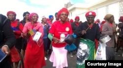 Women beating pots in Bulawayo telling President Robert Mugabe to go