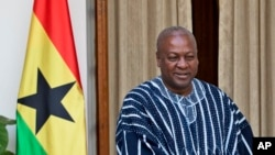 FILE - President of Ghana John Dramani Mahama is seen during a visit to New Delhi, India, Oct. 28, 2015. His critics say he is making his usual list of largely empty promises ahead December 7 election in his country.