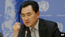 An Myong Hun, a North Korean official reacts to questions about the cyber-attack on Sony Pictures at United Nations headquarters on Jan. 13, 2015. (AP Photo/Frank Franklin II)