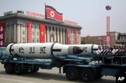 FILE - A submarine missile is paraded across Kim Il Sung Square during a military parade in Pyongyang, North Korea, April 15, 2017.