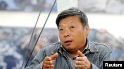 中國攝影記者盧廣資料照。