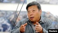 中国摄影师卢广出席平遥国际影大展(2014年9月20日)