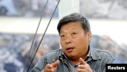 知名紀實攝影師盧廣。