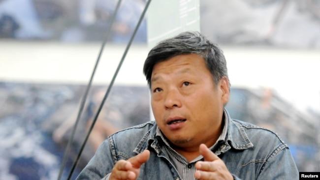 中国摄影记者卢广荣获国际新闻自由奖提名