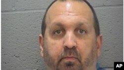 Cette photo de Craig Stephen Hicks, 46 ans, a été prise par le bureau du shérif du Comté de Durham, 11 février 2015.