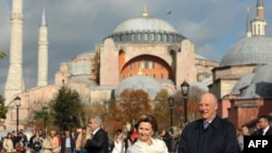 King Harald and Queen Sonja of Norway pose in front of Hagia Sophia Mosque on November 7, 2013 in Istanbul, Turkey.