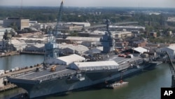 In this April 27, 2016 photo, USS Gerald R. Ford is stationed at Newport News Shipbuilding in Newport News, Va. The $12.9 billion warship is the first of the Navy's next generation of aircraft carriers.