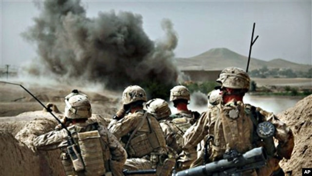 United States Marines watch the explosion after calling in an air strike to clear the area of insurgents near Musa Qaleh, southern Afghanistan (file photo – 23 Jul 2010)