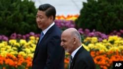阿富汗總統賈尼與中國國家主席習近平於2014年10月28日訪華時在人民大會堂接受歡迎儀式。