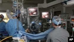 Doctors perform surgery using a robotic system.