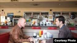 "Bruce Willis and Joseph Gordon-Levitt as ""Joe"" in TriStar Pictures, Film District, and End Game Entertainment's action thriller LOOPER."