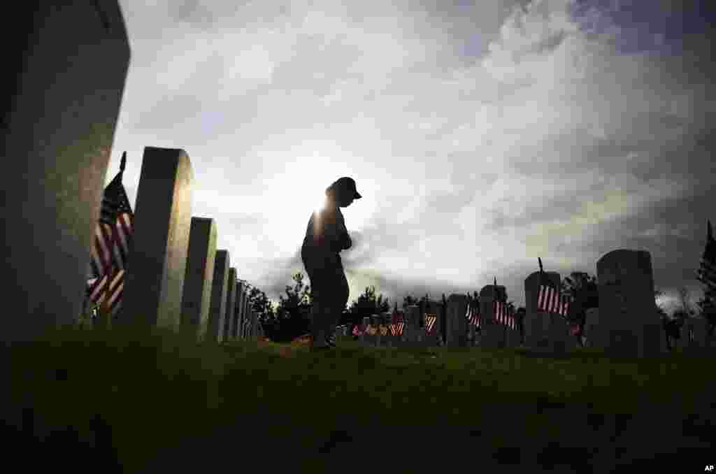 Lucille Williams walks through Georgia National Cemetery while visiting the grave of her late husband, Korean War veteran Sgt. 1st Class Alvin Williams, Canton, Ga., May 25, 2015.