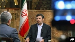 Iranian President Mahmoud Ahmadinejad speaks with state television about Iran's nuclear ambitions during a live program in Tehran, Dec 18, 2010