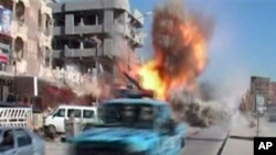 Image showing the moment that a bomb detonates on a street in Kirkuk, Iraq, February 9, 2011